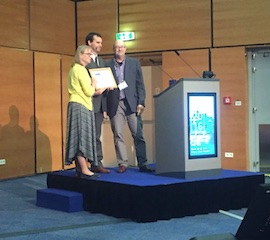Thomas Zeyda (inGenious Targeting Laboratory) and Jan Parker-Thornburg (ISTT President) present the Young Investigator Award to Dr. Pablo Ross, UC Davis.